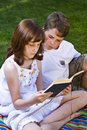 Portrait of cute kids reading books Stock Images