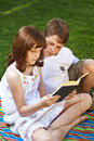 Portrait of cute kids reading books  in natural environment Stock Photo