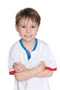 Portrait of a cute little boy closeup smiling against the white background Stock Photography