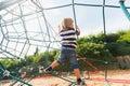 Portrait of a cute little boy having fun on playground wearing swearshirt and denim shorts Stock Photos