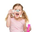 Portrait of a cute little girl blowing soap bubbles Royalty Free Stock Photography