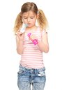 image photo : Portrait of a cute little girl blowing soap bubbles