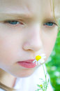 Portrait of a cute little girl with daisy Royalty Free Stock Photo