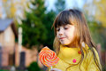 Portrait of cute little girl eating big lollipop Stock Images