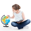 Portrait of a cute little girl with a globe isolated on white Royalty Free Stock Photography