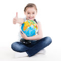 Portrait of a cute little girl with a globe isolated on white Stock Photos