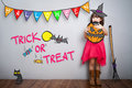 Portrait of cute little girl with halloween costume decoration t Royalty Free Stock Photo