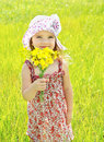 Portrait of cute little girl holding the flowers Royalty Free Stock Images