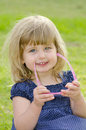 Portrait of cute little girl in the park Stock Photos