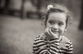 Portrait of cute little girl in a park black and white close up beautiful child outdoors greyscale Royalty Free Stock Image