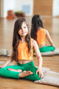 Portrait of a cute little smiling girl practicing yoga