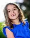 Portrait of cute smiling child natural with greenery in the background Royalty Free Stock Photo