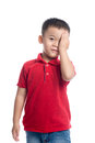 Portrait of cute smiling little boy closed one eye with his hand Royalty Free Stock Photo