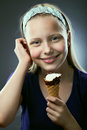 Portrait of a cute teen girl with icecream closeup studio shot Stock Photo