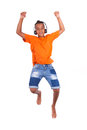 Portrait of a cute teenage black boy jumping over white background african people Stock Photo