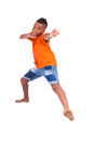 Portrait of a cute teenage black boy jumping over white background african people Stock Image