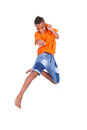 Portrait of a cute teenage black boy jumping over white background african people Royalty Free Stock Image