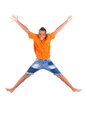 Portrait of a cute teenage black boy jumping over white background african people Royalty Free Stock Images