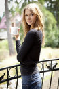 Portrait of cute teenage girl with cup of coffee Stock Image
