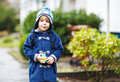 Portrait of cute toddler boy smiling on cold winter day in warm clothes Royalty Free Stock Photos