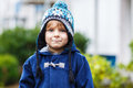 Portrait of cute toddler boy smiling on cold winter day in warm clothes Royalty Free Stock Photo