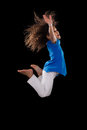 Portrait cute young african american girl jumping over black background Stock Photos