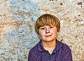 Portrait of a cute young boy with old brick background Royalty Free Stock Image