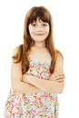 Portrait of a cute young girl standing with folded hands over white background Royalty Free Stock Images