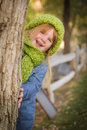 Portrait of cute young girl wearing green scarf and hat smiling posing for a outside Stock Photography