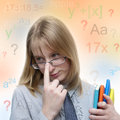 Portrait of a cute young student girl with pondering gesture Stock Photo