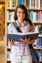 Portrait of a cute young student holding a book Royalty Free Stock Photo