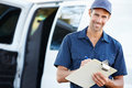 Portrait of delivery driver with clipboard smiling towards camera Stock Photo