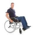 Portrait of disabled man on wheelchair full length over white background Stock Photos