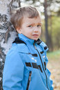 Portrait of  disaffected young boy, fall, park Stock Image