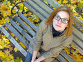 Portrait of dreaming teenage girl in the autumn park Stock Image