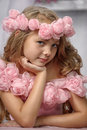 Portrait of dreamy girl with pink flowers on her head Royalty Free Stock Photos