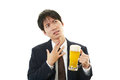 Portrait of a drunk man businessman with beer Stock Photo