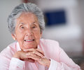 Portrait of an elder woman a beautiful smiling at home Stock Photography