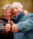 Portrait of elderly couple showing thumbs up Stock Image
