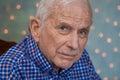 Portrait of elderly man wearing bright blue shirt Royalty Free Stock Photo