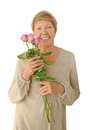 Portrait of elderly woman with bouquet roses Royalty Free Stock Images