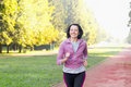 Portrait of elderly woman running in the park Royalty Free Stock Photo