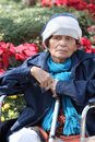 Portrait of elderly woman on trolley and cold weather. Royalty Free Stock Photo