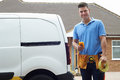 Portrait Of Electrician With Van Outside House Royalty Free Stock Photo