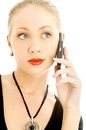 Portrait of elegant blond using cellular phone over white Stock Photo