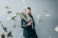 Portrait of elegant businessman with falling dollar banknotes Royalty Free Stock Photo