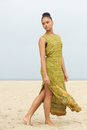 Portrait of an elegant fashion model walking at the beach full length Royalty Free Stock Photo