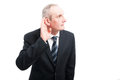 Portrait of elegant senior making can`t hear you gesture Royalty Free Stock Photo
