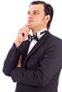 Portrait of an elegant young fashion man  looking away with his Royalty Free Stock Photo
