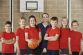 Portrait Of Elementary School Basketball Team With Coach Royalty Free Stock Photo